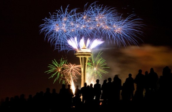 Spectators-at-Gas-Works-Park-watch-fireworks-light-up-the-iconic-Space-Needle-as-the-new-year-begins-on-Sunday-January-1-2012-in-Seattle-Washington.-AP-Photoseattlepi.com-Joshua-Trujillo-650x425