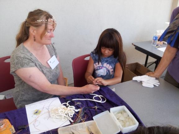 Jeni Cottrell teaching wire and beach glass jewelry. Photo Credit: Mary Jo Maute.