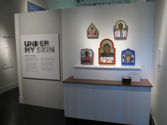 Exhibit text for Under My Skin was jointly written by a community member who is a journalist and by Mikala Woodward, exhibit developer at The Wing. This collaboration made it possible to cover more ground, including individual interviews with all 26 artists represented in the exhibit. Photo credit: The Wing Luke Museum