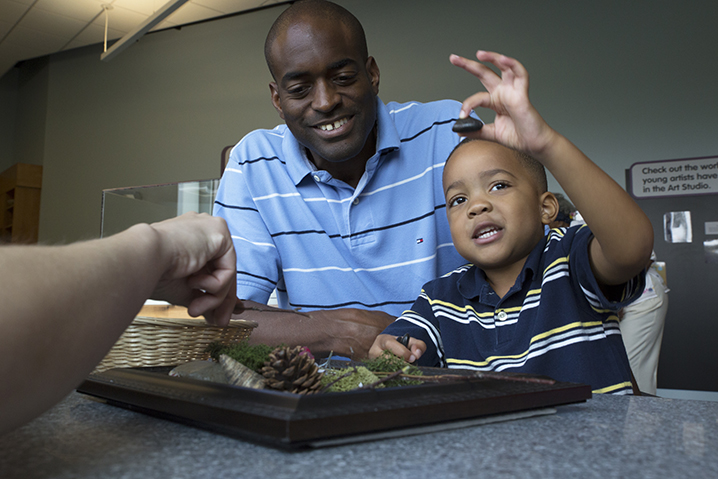 A family participates in museum activities through the Access Membership Program at the Children's Museum of Indianapolis.  Photo Credit: Children's Museum of Indianapolis.